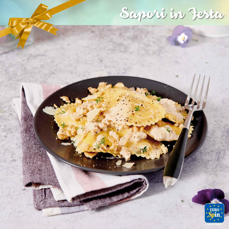 Mezzelune con parmigiano e tartufo con salsa di noci